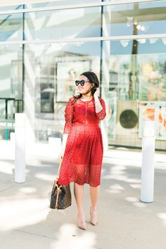 red holiday dress with nude pumps