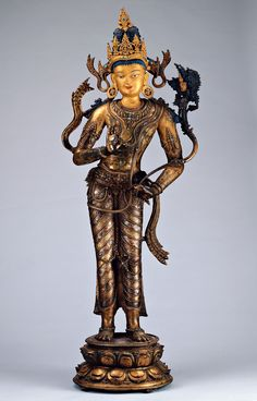 The Bodhisattva Maitreya. North-East India late Pala era, 11th -12th C. Copper base alloy, decorated with gold and paint, inlays of precious stones (mainly turquoise), silver and copper.