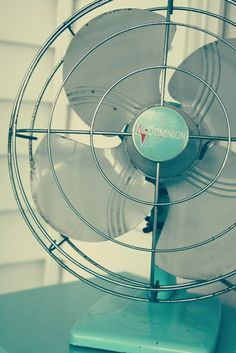 vintage turquoise fan, I have the late WESTINGHOUSE modle fan in brown but i would really love this fan as well!