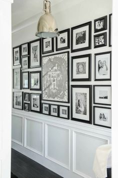 black & white gallery wall with wainscoting