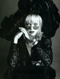 Reminiscent of the shabby chic style she made popular in the 80's..still works for her..the power of Madge.