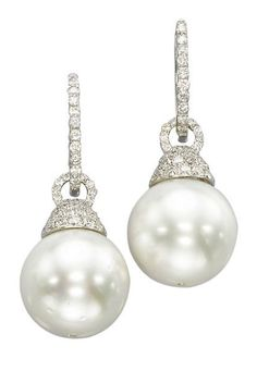 Lot Description  A PAIR OF CULTURED PEARL AND DIAMOND EAR PENDANTS   Each set with a cultured pearl measuring approximately 15.1 x 14.9 mm to the pavé-set diamond cap and detachable diamond line surmount, mounted in 18k white gold, 3.8 cm long