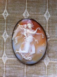 Antique Shell Cameo of The Goddess Aurore with Her Son Hypnos   ...Sold for $815 in Nov. 2012
