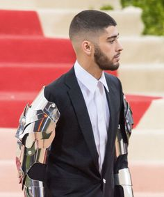 This is for the man who wants something like a buzzcut only with a bit more personality. Ask your barber for a skin fade, or, if you don't want that much skin showing, fade up from the sides and back with a 1 blade. Go with whatever length you want on top, although for a sharper look like Zayn Malik, it's better to keep it pretty short.
