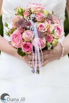 Bridal bouquet: July   -   Some of the used flowers: rose | masterwort | wax flower