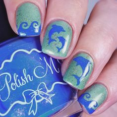 Dolphin Nail Art. Here are some cute little dolphins stencils you can get creative with for your nautical nails.