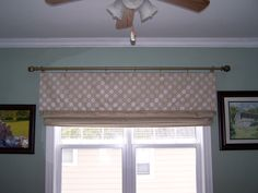 Valance and roman shade.  For valance put blind slats taped together and held in place with strips of elastic inside top edge of valance to keep a no sag edge.