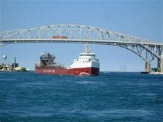 BLUE WATER BRIDGE, PORT HURON, MICHIGAN -- I used to watch and listen to the whistles of these freighters when they were traveling up and down the channel on Lake st. Clair.  I lived a block away from the lake and those whistles haunted me.  They were comforting and sad, all at the same time.