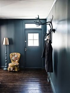 Beautiful blue walls - Love the antlers to hang up stuff!