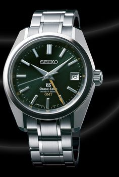 Grand Seiko GMT, limited edition w/ green dial and yellow GMT hand.