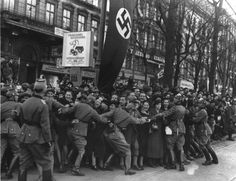 March 1938, Vienna, Austria.  Police trying to control the masses upon the arrival of Hitler.