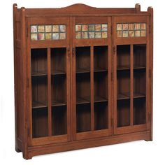 Stickley Brothers bookcase with slag-glass panes at top.  Via Treadway Galleries.