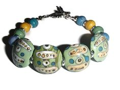 Lampwork Ceramic Bead Bracelet.  Lampwork and Howlite Bracelet. Beaded Bracelet. Mixed Colors by riversedgecreations. Explore more products on http://riversedgecreations.etsy.com