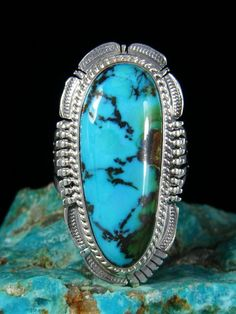 """Sierra NevadaTurquoisein a sterling silver ring setting by Native American artist, Bennie Ration. Face width is 1 1/2"""" x 3/4""""Size10"""