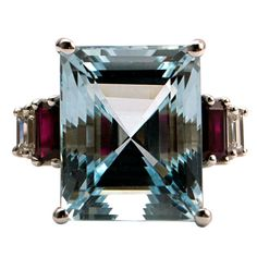 Art Deco Aquamarine Ruby Diamond Ring  USA  Art Deco  18K White Gold Ring with Aquamarine (cts 12.60) Baguette Rubies (cts 0.78) Baguette Diamonds (cts 0.22) E color VVS Clarity