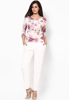 Show the world that your fashion sense is not only urbane but also exclusive by wearing this off-white coloured top from Dorothy Perkins. Fashioned from 100% polyester, this top will keep you comfortable all day long. Featuring a floral print, this top will look best when teamed with a pencil skirt and high heels.