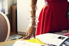 a slew of lucite bangles. big impact, light visual weight.