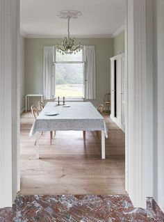 A bare dining room floor reflects summery light from a generous window in the 17th-century manse of Belgian architectsbuyse seghers architects frederik vercruysse photographer