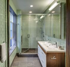 Green glass subway tile in the bathroom. Huge shower! Love the tile on the floor.