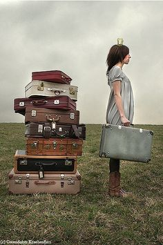 #suitcases #woman #land