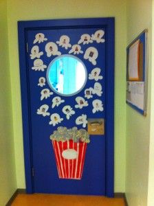 Nice way to decorate a classroom door. Sts' pictures are on the corns.