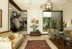 Living Room with rugs designed by Kumar Moorthy Associates. - Feste Home Decor indian home decor Living Room with rugs designed by Kumar Moorthy Associates Indian Living Rooms, Living Room Modern, Living Room Interior, Rugs In Living Room, Living Room Decor, Room Rugs, Living Room Designs India, Indian Home Interior, Indian Home Decor
