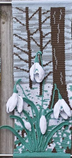 These wall hangings are created using Tapestry Crochet for the background. The flowers use florists wire and wadding to create a 3-D effect and are appliquéd to the background. Nearly all of the flower parts are worked in dc (US-sc) and, provided you take the instructions step by step, are not complicated.Materials: DMC Natura Just Cotton, Florists wire. The florists wire I use is 30cm (12inch) lengths of gauge 28. It is available from most florists or on eBay.Equipment: 2.5mm hook, tapestry…