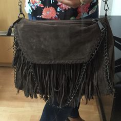 NWT Brown Faux Suede Fringe Purse Beautiful and very roomy brown fringe bag. Can be shoulder or hand bag. Gorgeous!! Bags