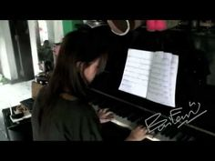 BAIFERN PIMCHANOK (playing the piano)