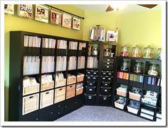 Scrapbook Room Organization ~ I love the rod with finished pages hanging from it!!