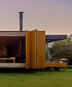 casa MCNY in brazil by mf+ arquitetos has retractable floor-to-ceiling shutters
