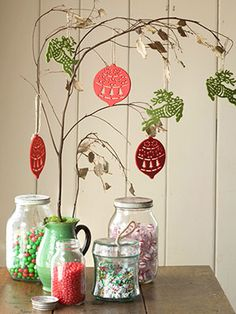 Jars filled with candy, some branches and ornaments will make a cute Christmas tree