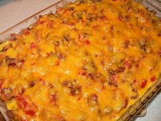 Breakfast Casserole Supreme- ( eggs, cheese, meat, sweet onions, tomatoes, peppers, hash browns)