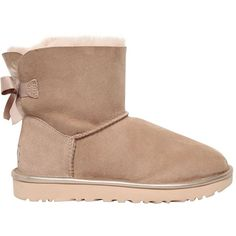 Ugg Australia Women Mini Bailey Bow Metallic Shearling Boots ($325) ❤ liked on Polyvore featuring shoes, boots, beige, beige boots, ugg boots, shearling lined shoes, mini shoes and self tying shoes