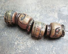 Polymer clay barrel beads and spacers with organic patterns in gold copper and bronze