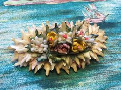 Floral Brooch/Pin Made From Shark's Teeth and Sea Shells by SinkingCreekVintage on Etsy https://www.etsy.com/listing/483411433/floral-broochpin-made-from-sharks-teeth