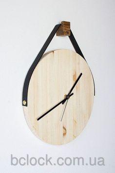 Деревянные настенные часы от компании B'Clock.:
