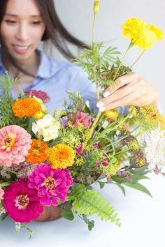 STEMS Floral Design + Productions   Austin Wedding Florist   Bright Summer Centerpiece   Zinnias   Inbal Sivan Photography