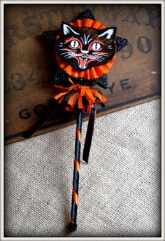 """Black Cat Wand ~ vintage-inspired Halloween accent, 12"""" wooden dowel wrapped in ribbon, w/glitter, tinsel, & crepe paper fringe 