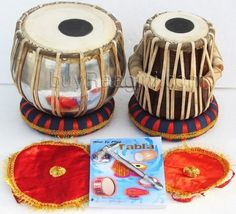 Student Model Classic Steel Tabla Set 2 KG (PDI-IB) by buyRaagini.com. $169.00. Tabla is a pair of drums that seems to have come to India in 13th century. It is used in Hindustani classical as well as light music. A tabla set comprises two drums with animal skin to cover heads. The two drums are bass drum and Treble drum. Bass, also called bayan is the bigger drum, played with the left hand, and the treble, also called dayan, is placed on the right. The bayan is...