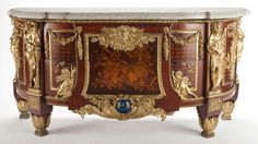 A LOUIS XVI-STYLE GILT BRONZE, MAHOGANY INLAID COMMODE AFTER THE MODEL BY JEAN-HENRI RIESENER . France, circa 1900.