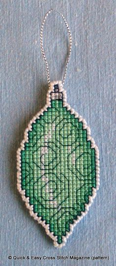 This pattern from Quick & Easy Magazine was perfect for creating a hangable Christmas tree decoration in a variety of colours. I made this one in cross stitch on a 14ct plastic canvas rectangle using stranded cotton threads of varying shades of green. Then I cut very carefully around the bauble leaving one line of canvas intact all round, which I oversewed in white perle.