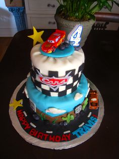 Cars Pixar movie cake I made out of fondant. First fondant cake made! Wahoo! I'm happier than a tornado in a trailer park!