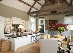 Ina Garten's kitchen features lamps on the 18 foot long island. Note the novel approach to overhead lighting above the island.