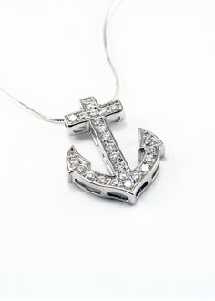 Beautiful Delta Gamma sterling silver anchor pendant set with brilliant cubic zirconias and polished to a dazzling shine. Inspired by the