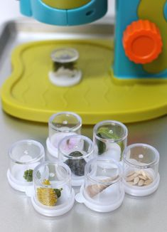 DIY microscope jars for a preschool science center in a preschool classroom. These jars let preschool teachers bring nature inside to be investigated. Science Area Preschool, Science For Toddlers, Preschool Garden, Preschool Centers, Preschool Learning Activities, Science Classroom, Teaching Science, Kid Science, Science Education