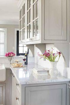 Light cabinets, light counters, subway tile backsplash
