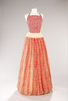 James Galanos (American, born 1924). Evening dress, ca. 1955. The Metropolitan Museum of Art, New York. Brooklyn Museum Costume Collection at The Metropolitan Museum of Art, Gift of the Brooklyn Museum, 2009; Gift of Mrs. Mortimer J. Solomon, 1978 (2009.300.527) | The choice of fabric is undoubtedly nautical inspired, the red and white undulating stripes representing rolling waves. #reddress