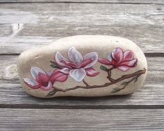 Pretty Magnolia Blossoms Painted Rock. $25.00, via Etsy.
