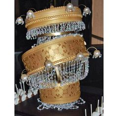 A little dramatic, no? This golden three-tiered cake was inspired by the grand chandelier in The Phantom of the Opera.   - Delish.com